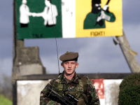 A British soldier patrols October 24, 2001 in the village of Crossmaglen, Northern Ireland. Four British Army security installations are to be dismantled in the wake of disarmament by the Irish Republican Army.