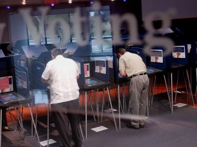 Two men were casting early ballots for the upcoming election at the Miami-Dade election headquarters in Miami, Fl. File