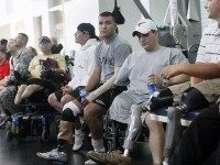 Wounded soldiers undergoing physical therapy wait for President Bush to visit a physical therapy lab for wounded soldiers at the Center For The Intrepid at the Brooke Army Medical Center in San Antonio, Thursday, Nov. 8, 2007. (AP Photo/Gerald Herbert)