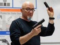 Mike Weinstein, director of training and security at the National Armory gun store and gun range, holds up a Glock 9mm hand gun during a Concealed Weapons Permit class, Tuesday, Jan. 5, 2016, in Pompano Beach, Fla. President Barack Obama unveiled his plan Tuesday to tighten control and enforcement of …