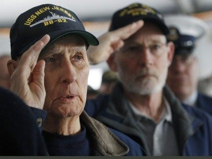 World War II veteran and original crew member of the battleship New Jersey, Russell Collins, left, salutes with others on the battleship during a commemoration of the 74th anniversary of the attack on Pearl Harbor, Monday, Dec. 7, 2015, in Camden, N.J. In Pearl Harbor, the U.S. Navy and National …