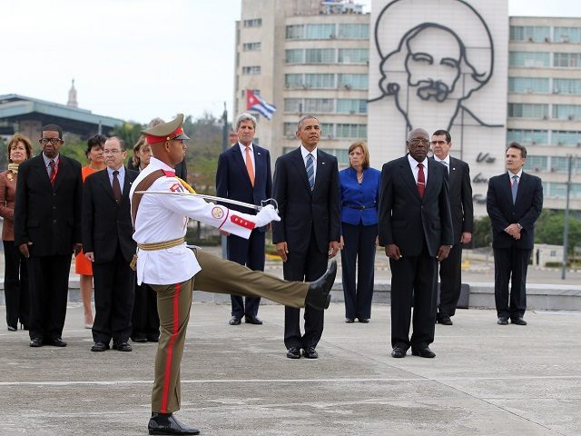 "U.S. President Barack Obama, center, and Secretary of State John Kerry, center left, stand as an honor guard marches during a ceremony at the Jose Marti monument in Revolution Square in Havana, Cuba, Monday, March 21, 2016. Third from right is Salvador Valdes Mesa Vice-President of Cuba's State Council. ""It is a great honor to pay tribute to Jose Marti, who gave his life for independence of his homeland. His passion for liberty, freedom, and self-determination lives on in the Cuban people today,"" Obama wrote in dark ink in the book after he laid a wreath and toured a memorial dedicated to the memory of Jose Marti. (AP Photo/Enric Marti)"