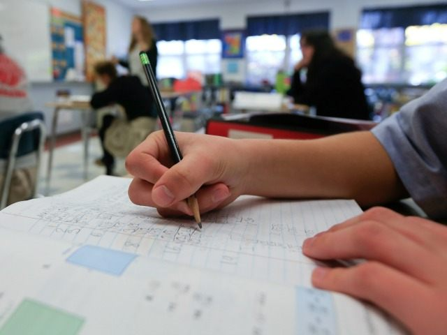 In this Nov. 17, 2015 photo, a student works in an eighth grade algebra class at Holy Spirit School in East Greenbush, N.Y.