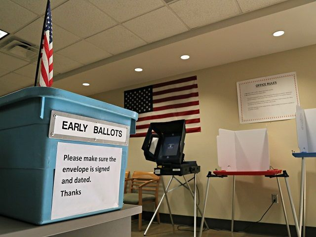 An example of an early ballot collection box and demonstration of voting areas is set up at the Maricopa County Recorder's office in Phoenix on Monday, March 21, 2016, ahead of the state's Presidential Primary Election on Tuesday. After a frenzied weekend of raucous campaign rallies across Arizona, election day …