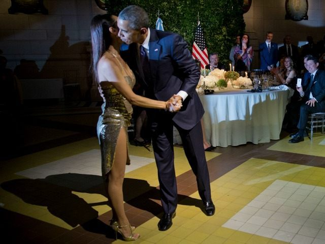 President Barack Obama kisses the dancer after doing the tango with her during the State Dinner at the Centro Cultural Kirchner, Wednesday, March 23, 2016, in Buenos Aires, Argentina.