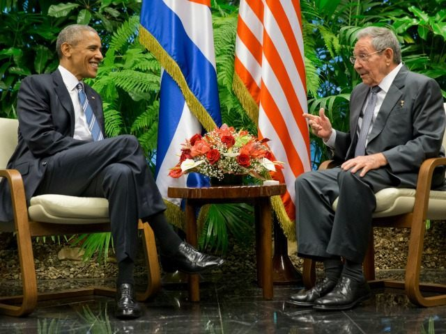 Cuban President Raul Castro, right, tries to lift up the arm of President Barack Obama at the conclusion of their joint news conference at the Palace of the Revolution, Monday, March 21, 2016, in Havana, Cuba.