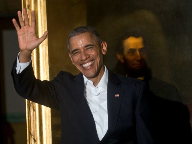 President Barack Obama waves to journalists next to a painting of President Abraham Lincoln at Havana's City Museum during a visit to Old Havana, Cuba, Sunday, March 20, 2016. Obama's trip is a crowning moment in his and Cuban President Raul Castro's ambitious effort to restore normal relations between their …