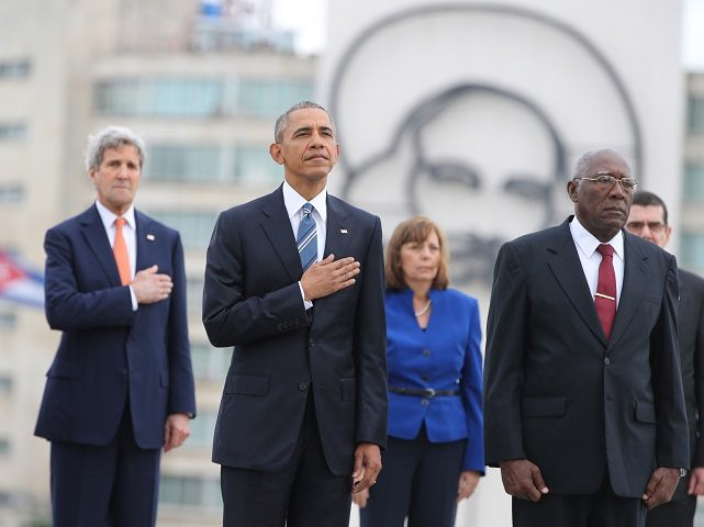 "U.S. President Barack Obama, center, and Secretary of State John Kerry, left, listen to the U.S. national anthem during a ceremony at the Jose Marti monument in Revolution Square in Havana, Cuba, Monday, March 21, 2016. At right is Salvador Valdes Mesa Vice-President of Cuba's State Council. ""It is a great honor to pay tribute to Jose Marti, who gave his life for independence of his homeland. His passion for liberty, freedom, and self-determination lives on in the Cuban people today,"" Obama wrote in dark ink in the book after he laid a wreath and toured a memorial dedicated to the memory of Jose Marti. (AP Photo/Enric Marti)"