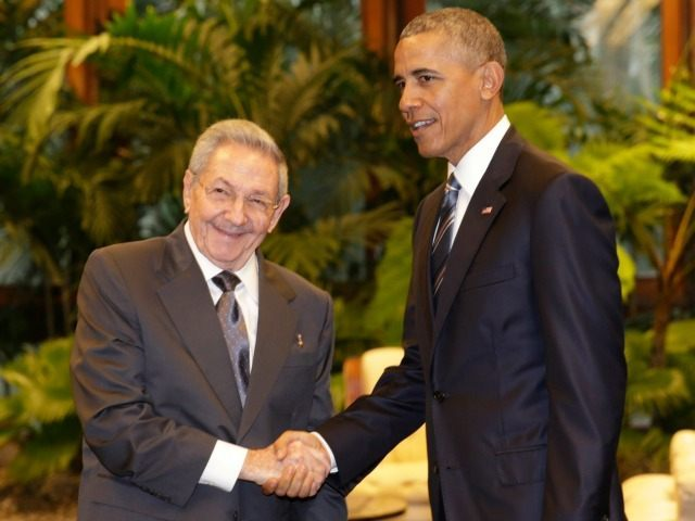 Cuban President Raul Castro, left, shakes hands with U.S. President Barack Obama during a meeting in Revolution Palace, Monday, March 21, 2016. Brushing past profound differences, President Obama and President Castro sat down for a historic meeting, offering critical clues about whether Obama's sharp U-turn in policy will be fully reciprocated.