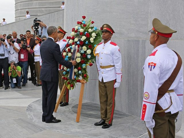 "U.S. President Barack Obama lays a wreath at the Jose Marti monument in Revolution Square in Havana, Cuba, Monday March 21, 2016. ""It is a great honor to pay tribute to Jose Marti, who gave his life for independence of his homeland. His passion for liberty, freedom, and self-determination lives on in the Cuban people today,"" Obama wrote in dark ink in the book after he laid a wreath and toured the memorial dedicated to the memory of Jose Marti. (AP Photo/Enric Marti))"
