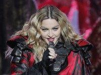 """FILE - In this Feb. 20, 2016 file photo,  Madonna performs during the Rebel Heart World Tour in Macau, China. Madonna says she would never perform at a concert """"high or drunk"""" in an Instagram post early Tuesday, March 15, 2016. The pop star played off the reported rumors that she appeared drunk onstage during her current world tour. (AP Photo/Kin Cheung)"""