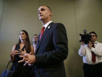 Lewandowski, center, looks on as Republican presidential candidate Donald Trump speaks at a news conference, Tuesday, Aug. 25, 2015, in Dubuque, Iowa. (AP Photo/Charlie Neibergall)