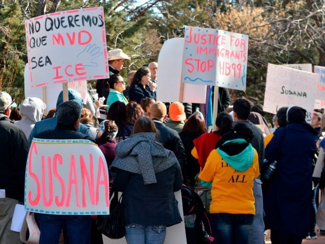 Jan. 25, 2016 file photo, immigrant advocates hold a rally outside the New Mexico statehouse to voice their opposition to a GOP-sponsored proposal that would make New Mexico REAL ID compliant by ending the practice of granting driver's licenses to immigrants in the country illegally. New Mexico Gov. Susana Martinez …