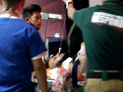 PHILIPPINES, Zamboanga : This screen grab taken from video on March 1, 2016 shows medical personnel transferring Saudi preacher Sheikh Aaidh al-Qarni (C) into hospital in the southern Philippine city of Zamboanga after he was wounded during an assassination attempt after giving an address at a university. Philippine authorities were …