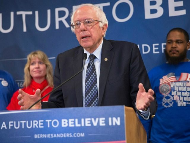 Democratic presidential candidate Senator Bernie Sanders (D-VT) holds a press conference with union workers to discuss the affect of free trade agreements on American workers on March 3, 2016 in East Lansing, Michigan.