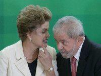 Brazil's President Dilma Rousseff talks with former President Luiz Inacio Lula da Silva during his swearing-in ceremony as the chief of staff, at the Planalto presidential palace, in Brasilia, Brazil, Thursday, March 17, 2016. Silva was sworn in as his successor's chief of staff on Thursday and Rousseff insisted he …