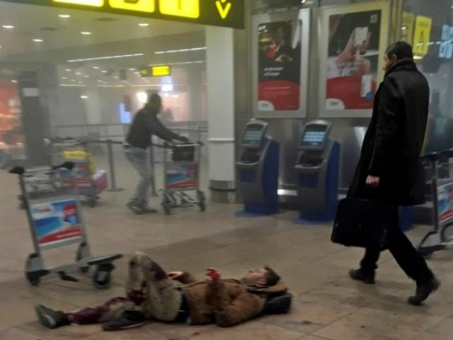Brussels-terrorism-man-down-ap