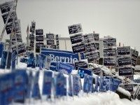signs of US Democratic presidential candidates Hillary Clinton and Bernie Sanders in Manchester, New Hampshire, on February 5, 2016.