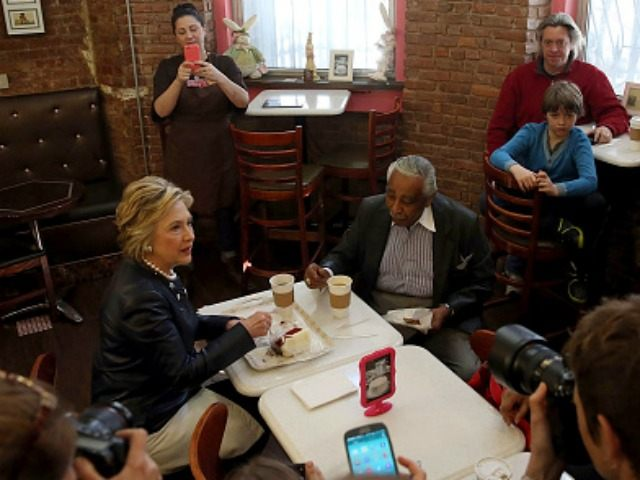 Democratic presidential candidate Hillary Clinton sits with Congressman Charles Rangel at Make My Cake in Harlem before an appearance at the Apollo Theater on March 30, 2016 in New York City.