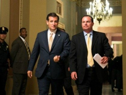 Sen. Ted Cruz (R-TX) and Sen. Mike Lee (R-UT) walk together after a Senate joint caucus meeting, on Capitol Hill, July 15, 2013 in Washington, DC.