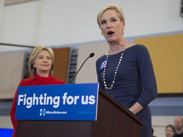 Planned Parenthood president Cecile Richards, right, applauds introduces Clinton during a campaign rally at Burford Garner Elementary School, on Sunday, Jan. 24, 2016, in North Liberty, Iowa. (AP Photo/Evan Vucci)