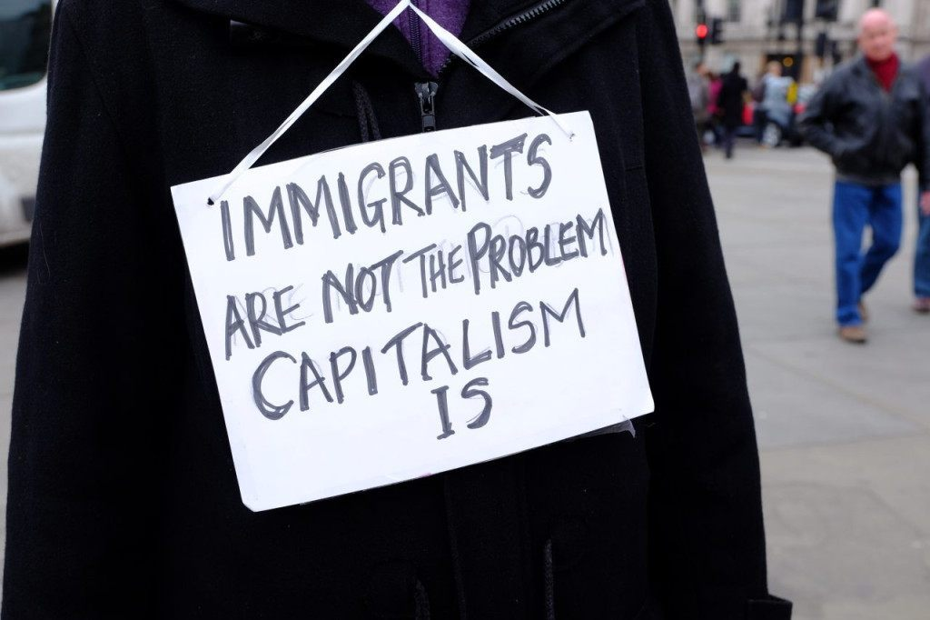 A demonstrator claims capitalism is to blame (Rachel Megawhat/Breitbart London)