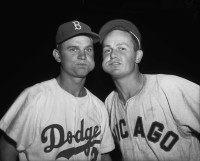 Nelson Fox of the Brooklyn Dodgers and Don Zimmer of the Chicago White Sox chewing tobacco.