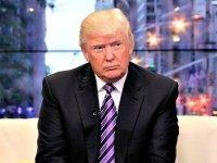 "FILE - This Sept. 16, 2013 file photo shows Donald Trump appears on the ""Fox & friends"" television program in New York. Trump has filed two ethics complaints against state Attorney General Eric Schneiderman, accusing him of misconduct. Trump says the Democratic attorney general solicited campaign donations from Trump's daughter …"