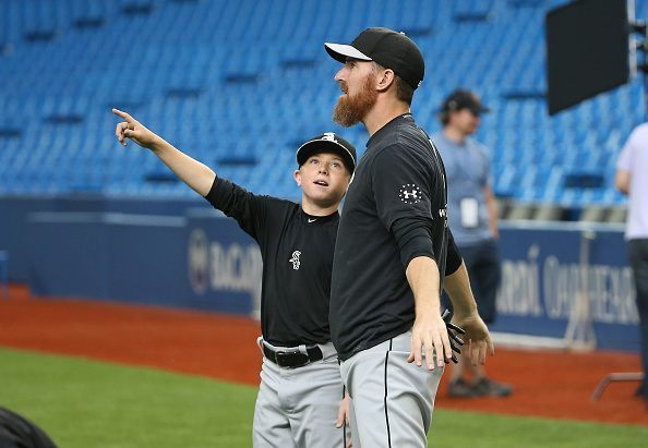 TORONTO, CANADA - MAY 25: Drake the son of Adam LaRoche #25 of the Chicago White Sox points to the roof as it opens during batting practice before the start of MLB game action against the Toronto Blue Jays on May 25, 2015 at Rogers Centre in Toronto, Ontario, Canada. …