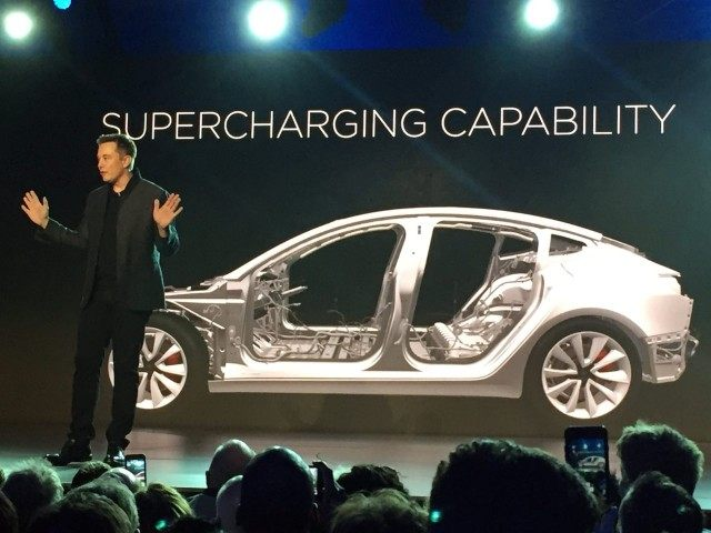 Elon Musk and Tesla 3 (Justin Prichard / Associated Press)