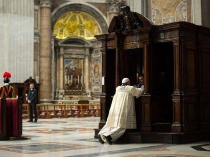 A priest hears confession from Pope Francis during a penitential liturgy in St. Peter's Basilica at the Vatican in this March 28, 2014, file photo. (CNS photo/L'Osservatore Romano via Reuters) See VATICAN-LETTER-CONFESSION March 3, 2016.
