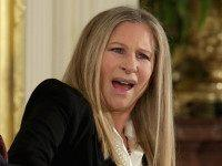 WASHINGTON, DC - NOVEMBER 24: Entertainer Barbra Streisand (R) reacts to the words President Barack Obama said about her before presenting her with the Presidential Medal of Freedom during a ceremony in the East Room of the White House November 24, 2015 in Washington, DC. Obama presented the medal to …