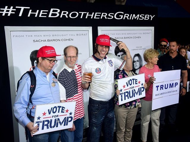 Actor Sacha Baron Cohen poses with supporters of Republican Presidential candidate Donald Trump before for the premiere of the film 'The Brothers Grimsby' in Los Angeles, California on March 3, 2016. / AFP / FREDERIC J. BROWN (Photo credit should read FREDERIC J. BROWN/AFP/Getty Images)