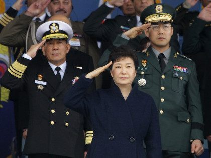 GYERYONG, SOUTH KOREA - MARCH 04: South Korean President Park Geun-Hye salutes during a military commissioning ceremony at Gyeryongdae, South Korea's main military compound on March 4, 2016 in Gyeryong, South Korea. Total 6003 graduates from the country's six major military academies were commissioned at the ceremony. (Photo by Chung …