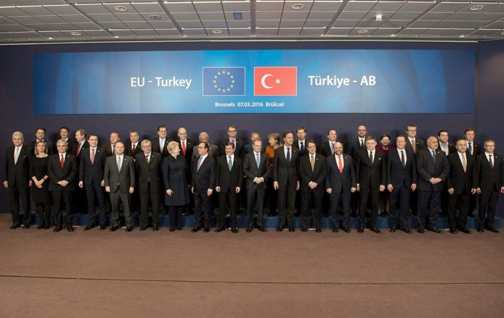 Turkish Prime Minister Ahmet Davutoglu (9th L) and European Council president Donald Tusk (9th R), pose for a family picture with European leaders during an EU leaders summit with Turkey on migrants crisis on March 7, 2016 at the European Council, in Brussels. European Union leaders will on March 7 back closing down the Balkans route used by most migrants to reach Europe, diplomats said, after at least 25 more people drowned trying to cross the Aegean Sea en route to Greece. The declaration drafted by EU ambassadors on March 6 will be announced at a summit in Brussels on March 7, set to also be attended by Turkish Prime Minister Ahmet Davutoglu. / AFP / ALAIN JOCARD (Photo credit should read ALAIN JOCARD/AFP/Getty Images)