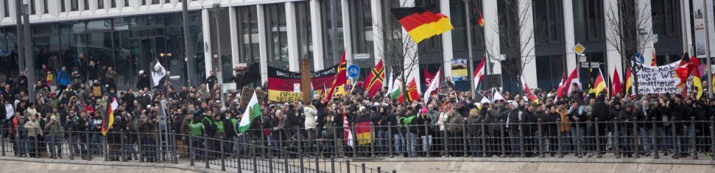 BERLIN, GERMANY - MARCH 12:  Right-wing activists march in the city center and protest against German Chancellor Angela Merkel on March 12, 2016 in Berlin, Germany. Germany will hold state elections in three states tomorrow and the right-leaning populist Alternative fuer Deutschland (Alternative for Germany, AfD) political party will very likely gain seats in all three state parliaments. AfD leaders however distanced themselves from today's right-wing march and urged AfD supporters not to participate. Right-wing groups are seeking to profit from the unease of many Germans with Merkel's liberal immigration policy that resulted in 1.1 million migrants and refugees arriving in Germany in 2015.  (Photo by Carsten Koall/Getty Images)