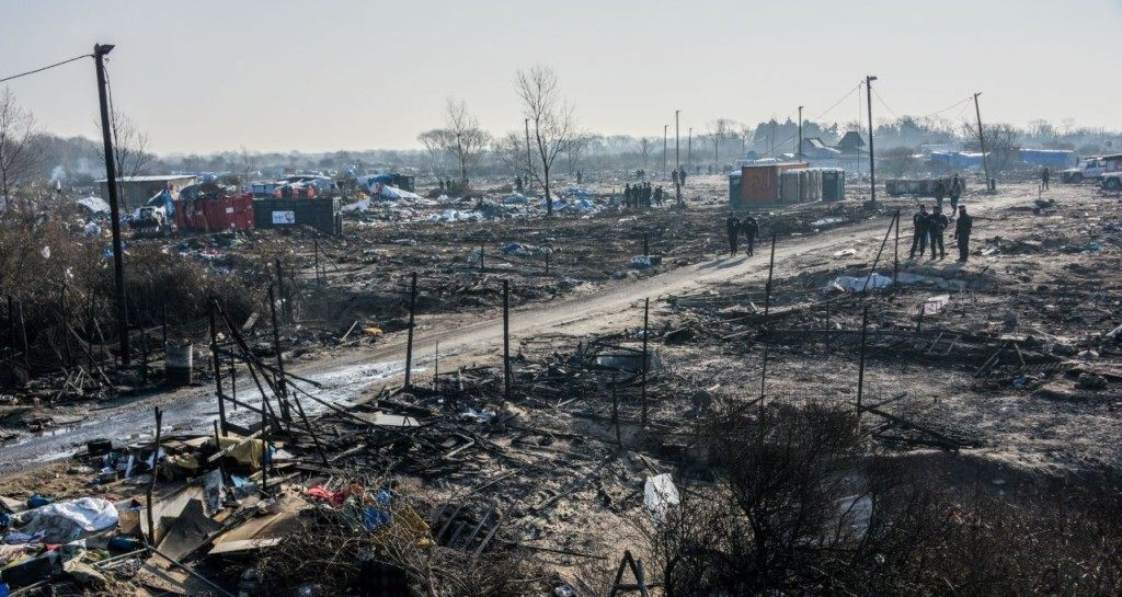 TOPSHOT - A general view taken on March 14, 2016 shows the southern part of the so-called 'Jungle' migrant camp during the dismantling in Calais, northern France. Thousands of migrants have been living in the Jungle and other smaller camps along the northern coast, desperate to reach Britain where many have family or community ties and see better hopes of gaining employment or education. / AFP / DENIS CHARLET (Photo credit should read DENIS CHARLET/AFP/Getty Images)