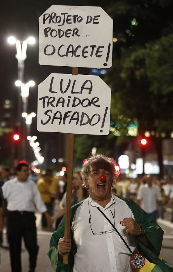 Demonstrators rally for Brazilian President Dilma Rousseff's impeachment along Paulista Avenue in Sao Paulo on March 16, 2016. Outraged Brazilians protested in Brasilia and Sao Paulo following the release of a taped phone call between President Dilma Rousseff and her predecessor Luiz Inacio Lula da Silva. On Sunday, an estimated three million Brazilians flooded the streets in nationwide protests calling for Rousseff's departure. / AFP / Miguel Schincariol (Photo credit should read MIGUEL SCHINCARIOL/AFP/Getty Images)