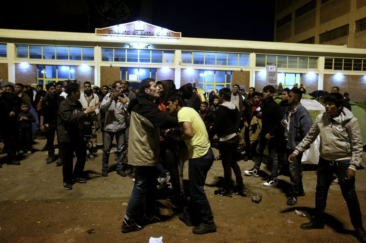 Migrants from Afghanistan clash with Syrians during a food distribution organised by the Olympiacos Piraeus local football team, at the port of Piraeus, on March 17, 2016, where thousands of migrants are stranded for several days. / AFP / PANAYOTIS TZAMAROS        (Photo credit should read PANAYOTIS TZAMAROS/AFP/Getty Images)