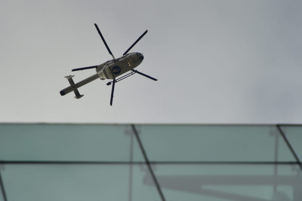 A helicopter of the Belgian police flies above the area near Maalbeek metro station, on March 22, 2016 in Brussels, after a blast at this station near the EU institutions caused deaths and injuries. AFP PHOTO / EMMANUEL DUNAND / AFP / EMMANUEL DUNAND (Photo credit should read EMMANUEL DUNAND/AFP/Getty Images)