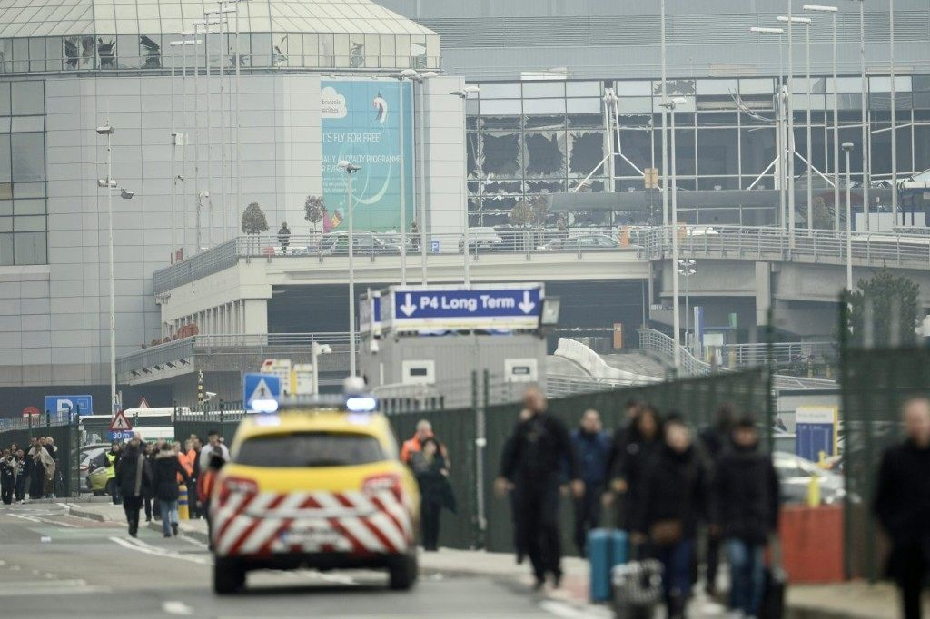 People are evacuated from Brussels Airport, in Zaventem, on March 22, 2016. after at least 13 people have been killed by two explosions in the departure hall of Brussels Airport. / AFP / Belga / VIRGINIE LEFOUR / Belgium OUT (Photo credit should read VIRGINIE LEFOUR/AFP/Getty Images)