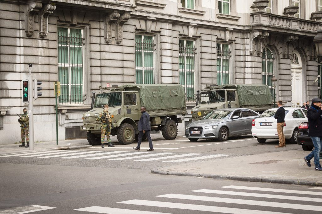Belgian servicemen block the road close to a meeting of the National Security Council at the Prime Minister's office, in Brussels, on March 22, 2016, after a string of explosions rocked Brussels airport and a city metro station, killing at least 21 people, as Belgium raised its terror threat to the maximum level. The blasts come days after the dramatic arrest in Brussels on March 18 of Salah Abdeslam, the prime suspect in the Paris terror attacks that killed 130 people in November, after four months on the run. / AFP / Belga / James Arthur Gekiere / Belgium OUT (Photo credit should read JAMES ARTHUR GEKIERE/AFP/Getty Images)