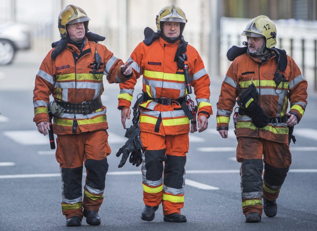 Firefighters arrive at a security perimeter set in the Rue de la Loi near the Maalbeek subway station, in Brussels, on March 22, 2016, after an explosion killed around 10 people, according to spokesman of Brussels' fire brigade A string of explosions rocked Brussels airport and a city metro station on Tuesday, killing at least 13 people, according to media reports, as Belgium raised its terror threat to the maximum level. / AFP / Belga / LAURIE DIEFFEMBACQ / Belgium OUT (Photo credit should read LAURIE DIEFFEMBACQ/AFP/Getty Images)