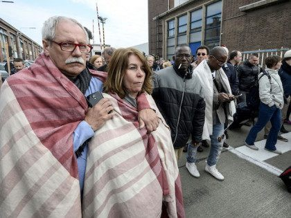 People are evacuated from Brussels airport in Zaventem on March 22, 2016 following twin blasts. A string of explosions rocked Brussels airport and a city metro station, killing at least 21 people in apparently coordinated attacks, officials said. == BELGIUM OUT == / AFP / Belga / DIRK WAEM / …