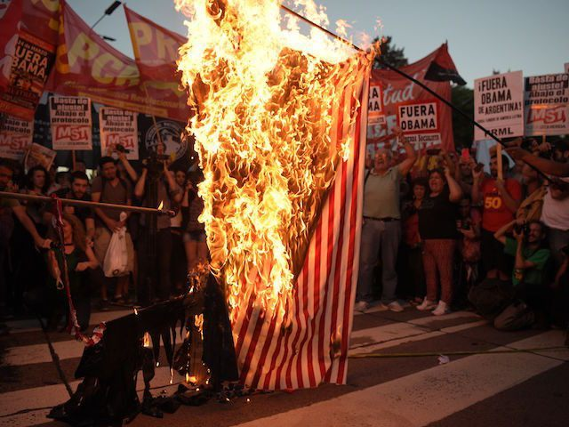 Members of leftist organizations burn a flag representing the US during a protest against the visit of US President Barack Obama, in Buenos Aires, on March 23, 2016. The United States and Argentina sealed a major trade deal on the eve -the first day of Obama's visit- bolstering the efforts …
