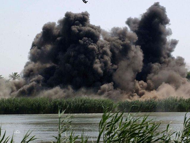 AD DULUIYAH, IRAQ - JULY 21: In this undated picture released by the U.S military on July 21, 2005, debris flies into the air after a 500 pound bomb dropped by the U.S. Air Force strikes a pontoon on a small island in the Tigris River near the town of …