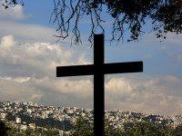 The town of Ajaltoun is seen behind a cross standing at the Christian Maronite church of Saint Elias, near the town of Zouk Mosbeh located north east of the Lebanese capital Beirut, on December 30, 2015. AFP PHOTO / PATRICK BAZ / AFP / PATRICK BAZ (Photo credit should read PATRICK BAZ/AFP/Getty Images)