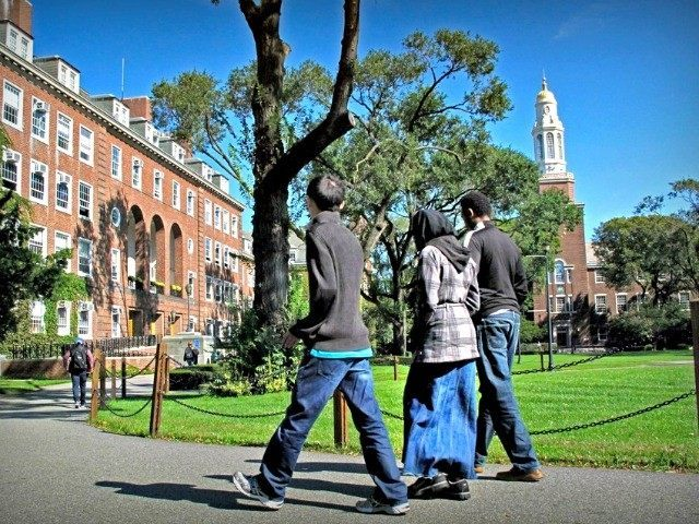 In this Friday, Oct. 7, 2011 photo, people walk on the campus of Brooklyn College in the Brooklyn borough of New York. Investigators have been infiltrating Muslim student groups at Brooklyn College and other schools in the city, monitoring their Internet activity and placing undercover agents in their ranks, police …