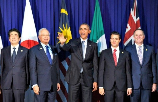 President Barack Obama and other leaders of the Trans-Pacific Partnership countries pose for a photo in Manila, Philippines, Wednesday, Nov. 18, 2015, ahead of the start of the Asia-Pacific Economic Cooperation summit. The leaders are, from left, Japan's Prime Minister Shinzo Abe, Malaysia's Prime Minister Najib Razak, Obama, Mexico's President Enrique Pena Nieto, New Zealand's Prime Minister John Key. (AP Photo/Susan Walsh)