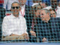 President Barack Obama (L) and Cuban President Raul Castro arrive for an exposition game between the Cuban national team and the Major League Baseball team Tampa Bay Devil Rays at the Estado Latinoamericano March 22, 2016 in Havana, Cuba.